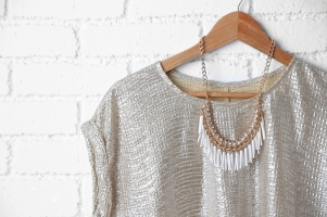 dress and necklace on hanger