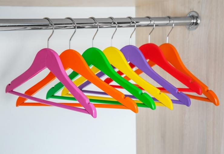 row of colourful coat hangers